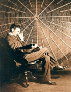 Nikola Tesla in front of the spiral coil of his high-voltage transformer at East Houston St., New York.